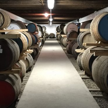 Whisky casks in a warehouse